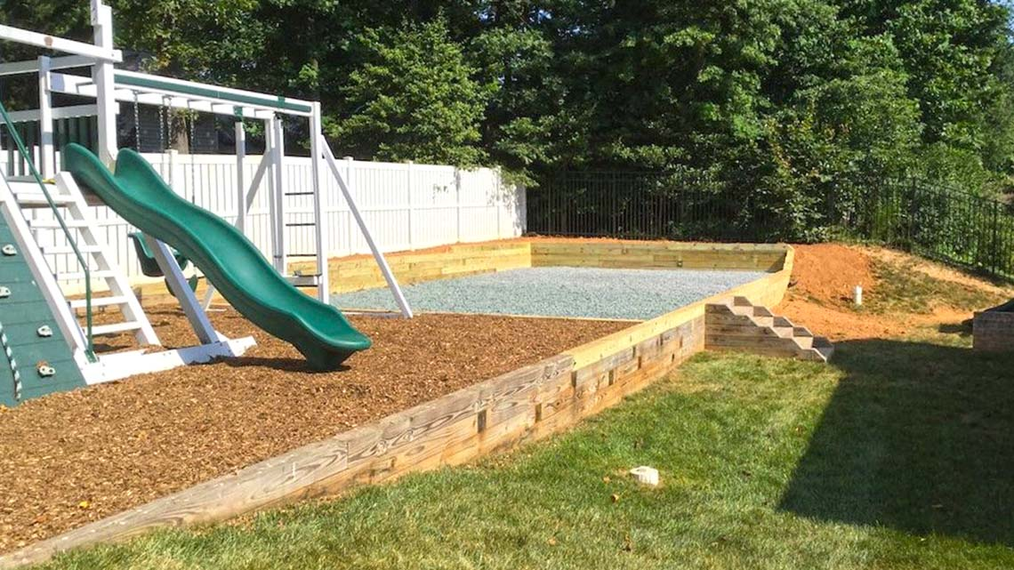 Swing Set and Shed Pad with Retaining Wall