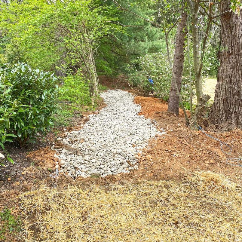Stone drainage area allows storm water to safely be absorbed
